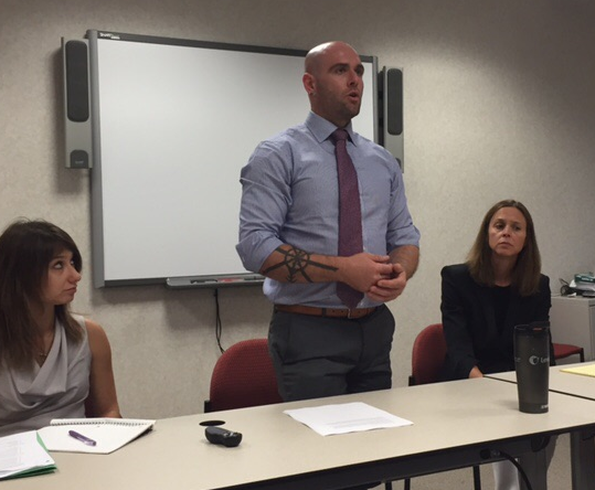 Former Intern Ethan Scrivner (center) presents an argument for disposition departure based on caregiver status under current Minnesota Law in a mock sentencing hearing. Veronica Horowitz (left) plays the role of an expert witness while Julie Matonich (right) plays the role of a prosecutor.